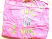 Colorful flower image on pink balinese crafted sarong