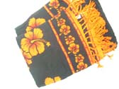 Spring fashion sarong in black and orange with hibiscus theme