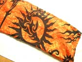 Fiery orange batik sarong with tribal sun and dolphin image