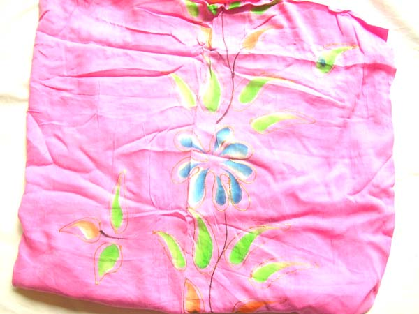 Colorful flower image on pink balinese crafted sarong, garment warehouse exchange