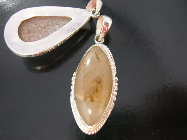 Quartz crystal fashions, gemstone jewelry, sterling silver pendant, ladies costume jewelry, high fashion apparel, unique designs